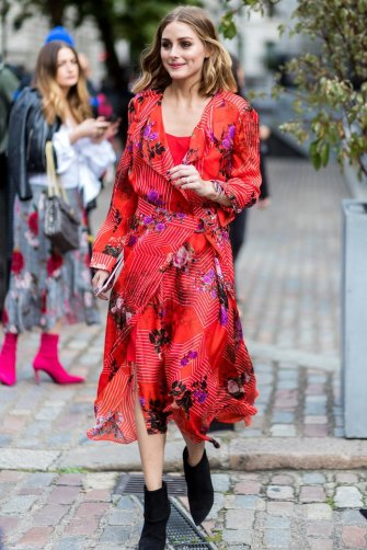 LONDON, ENGLAND - SEPTEMBER 17: Olivia Palermo wearing red dress outside Preen during London Fashion Week September 2017 on September 17, 2017 in London, England. (Photo by Christian Vierig/Getty Images)